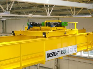 The overhead crane with rotating trolley