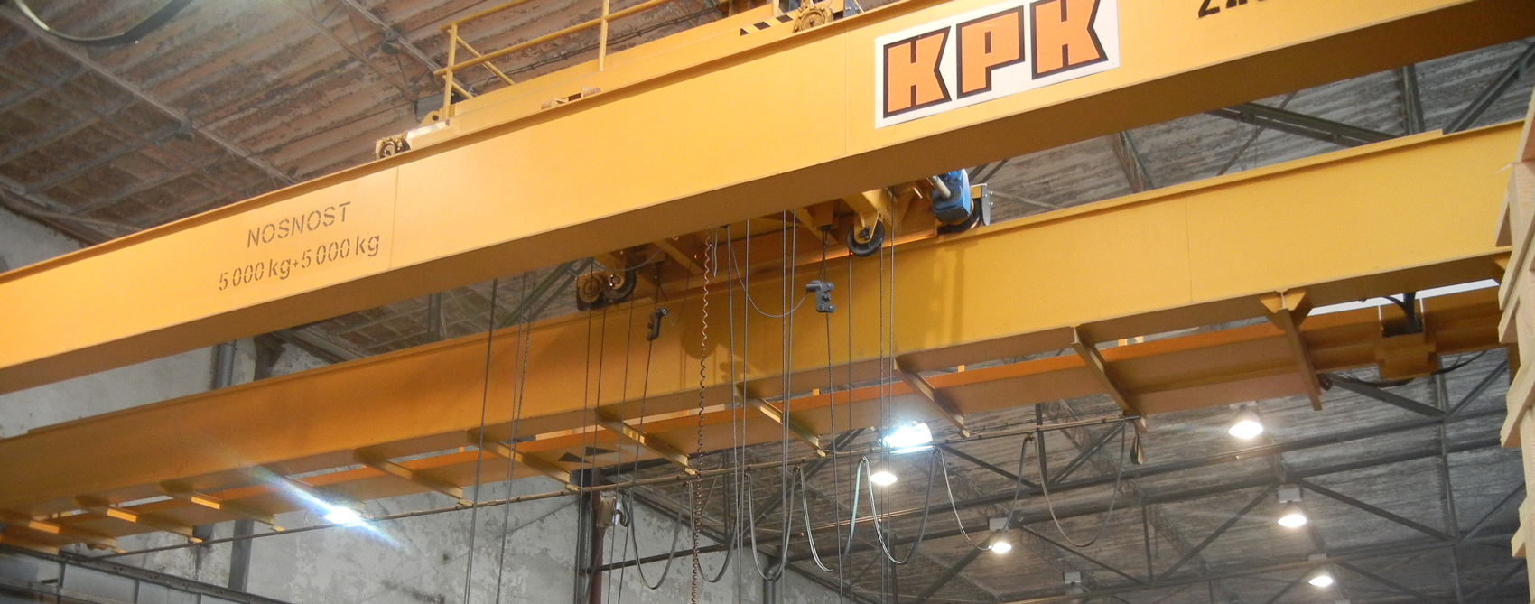 Double girder travelling cranes