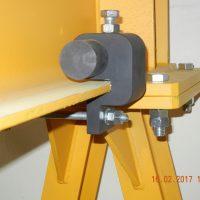 Movable bumper for hoists